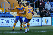Mansfield Town forward Nicky Maynard (11) celebrates with team mate Mansfield Town defender Joe Riley (18)  during the EFL Sky Bet League 2 match between Mansfield Town and Carlisle United at the One Call Stadium, Mansfield, England on 1 February 2020.
