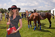 Nikolina Gora, Moscow Region, Russia, 25/06/2005..The Russian Polo Cup 2005, organised by the Russian Federation of Polo Players and the Moscow Polo Club. Guests inspect and photograph ponies in the paddock.