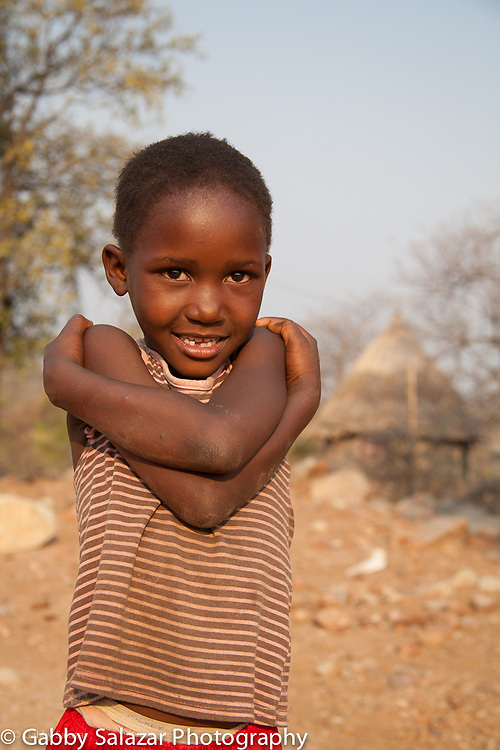 Young Venda girl in front of a hut in Hamakuya village in Limpopo Province, South Africa.