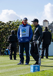 February 10, 2019 - Pebble Beach, CA, U.S. - PEBBLE BEACH, CA - FEBRUARY 10: Paul Casey chats with his caddie before his tee off time is delayed during the final round of play at the AT&T Pebble Beach Pro-Am on Sunday, February 10, 2019 in Pebble Beach, CA. (Photo by Douglas Stringer/Icon Sportswire) (Credit Image: © Douglas Stringer/Icon SMI via ZUMA Press)