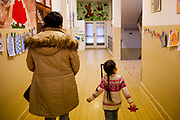 Daniela Kroscenova (27) with her daughter Esther Kroscenova (6) walking in the hall way of ZS Chrustova elementary school to an enrollment examination (test). Esther should be a first class pupil in the school year 2016/2017 in a mainstream school in the city of Ostrava, where Roma and non Roma children are educated together.