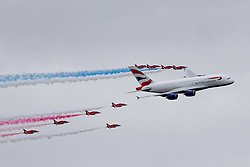 © under license to London News Pictures. 20/07/13 The Red Arrows fly in formation with the new British Airways Airbus A380 at the Royal International Air Tattoo at RAF Fairford<br /> <br /> Photo credit should read IAN SCHOFIELD/LNP