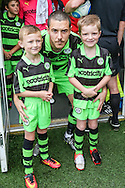 Forest Green Rovers Liam Noble(15) with the mascots during the Vanarama National League match between Forest Green Rovers and Barrow at the New Lawn, Forest Green, United Kingdom on 1 October 2016. Photo by Shane Healey.