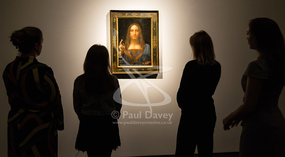 London, October 24 2017. Viewers admire Leonardo da Vinci's Salvator Mundi ('Saviour of the World') at a gallery preview at Christie's in London. The painting sold at Christie's in New York on 15 November 2017 for $450.3 million at Christie's New York, the highest price for any work of art. The painting is one of fewer than 20 known paintings by Leonardo, and the only one in private hands. © Paul Davey