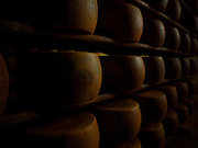 Stacks of Parmagianno-Reggiano in the famous Parmagianno-Reggiano factory in Parma Italy.
