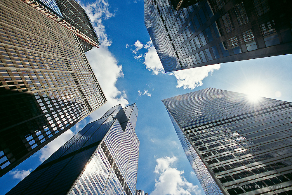 Wide-angle view looking up at office buildings in downtown Chicago, Illinois