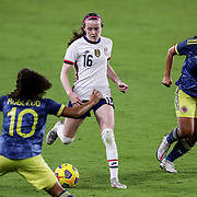 ORLANDO, FL - JANUARY 22:  Rose Lavelle #16 of United States controls the ball against Gisela Robledo #10 of Columbia and Catalina Usme #11 of Columbia at Exploria Stadium on January 22, 2021 in Orlando, Florida. (Photo by Alex Menendez/Getty Images) *** Local Caption *** Rose Lavelle; Gisela Robledo; Catalina Usme