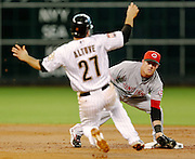 July 24, 2012; Houston, TX, USA; Cincinnati Reds shortstop Zack Cozart (2) tags out Houston Astros second baseman Jose Altuve (27) to complete a double play during the first inning at Minute Maid Park. Mandatory Credit: Thomas Campbell-US Presswire