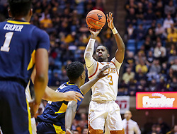 Feb 9, 2019; Morgantown, WV, USA; Texas Longhorns guard Courtney Ramey (3) shoots a three pointer during the first half against the West Virginia Mountaineers at WVU Coliseum. Mandatory Credit: Ben Queen-USA TODAY Sports