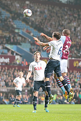 Aston Villa's Jordan Bowery and Tottenham Hotspurs' Vlad Chiriches go for the ball  - Photo mandatory by-line: Nigel Pitts-Drake/JMP - Tel: Mobile: 07966 386802 24/09/2013 - SPORT - FOOTBALL -  Villa Park - Birmingham - Aston Villa v Tottenham Hotspur - Round 3 - Capital One Cup