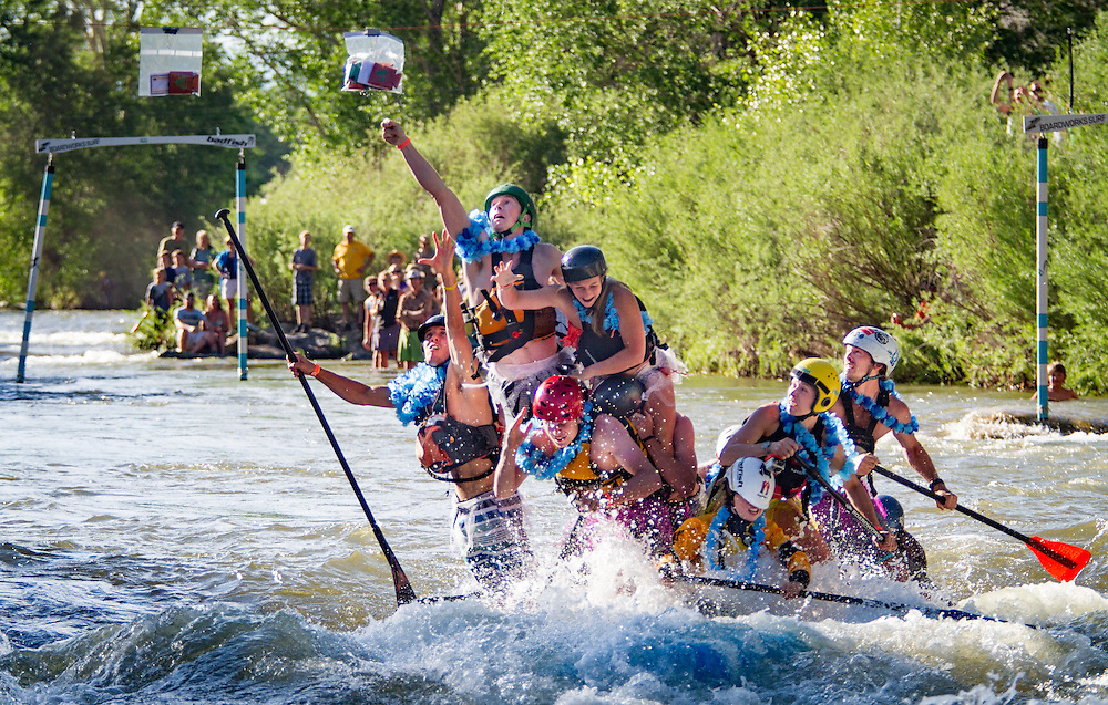Paddlers of makeshift watercraft join in the Hooligan Race a the FibArk whitewater festival.