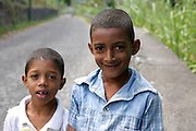 Children in Vale do Paul. The pedestrian road of this valley enables the vision of an extraordinary scenic beauty because the valley starts in the hillside of a volcanic crater and goes down to the sea.