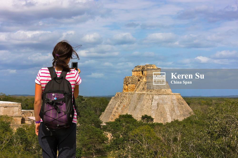 Tourist photographing the Magician Pyramid, Uxmal, Yucatan, Mexico