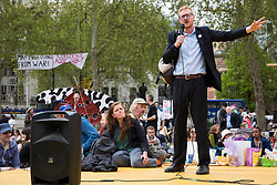 London, UK. 23rd April 2019. Lloyd Russell-Moyle, Labour MP for Brighton Kemptown, addresses climate change activists from Extinction Rebellion at an assembly in Parliament Square prior to an attempt to deliver to Parliament activists' letters requesting meetings to discuss climate change with their Members of Parliament.
