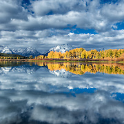 While camping in the Grand Teton National Park at the start of the Government Shutdown of 2013, all National Park entry was closed. I was allowed access for a few more days as I was already in the park. This spot, Oxbo Bend, is covered with photographers during this season. Though with a shutdown, there were only two or three, and allowed me to get a dramatic angle of the cloud reflection.