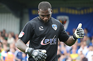 Oldham Athletic goalkeper Johny Placide (19) giving a thumbs up during the EFL Sky Bet League 1 match between AFC Wimbledon and Oldham Athletic at the Cherry Red Records Stadium, Kingston, England on 21 April 2018. Picture by Matthew Redman.