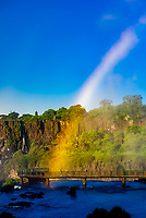 Rainbow, Iguazu Falls (Iguacu in Portugese), on the border of Brazil and Argentina. It is one of the New 7 Wonders of Nature and is a UNESCO World Heritage Site. There are 275 waterfalls total which make up the largest waterfalls in the world. This photo is on the Brazil side of the Falls.