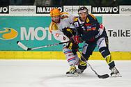 29.03.2011, Kloten, Eishockey NLA Playoff, Kloten-Flyers - SC Bern, Topscorer Christian Dube (BER) gegen Marc Welti (KLO)  (Thomas Oswald/hockeypics)