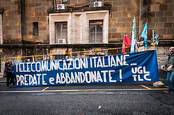 November 22, 2018 - Rome, Italy - Tim, Slc-Cgil, Fistel-Cisl and Uilcom-Uil in defense at Mise against the hive-off of the Tim network could cause about 20 thousand redundancies. It is the alarm launched by the trade unions (Slc-Cgil, Fistel-Cisl and Uilcom-Uil), which are implementing a garrison in front of the Ministry of Economic Development (Mise) to protest against the cancellation of the meeting with the vice-premier and minister Luigi Di Maio, which should have been held this day. (Credit Image: © Andrea Ronchini/Pacific Press via ZUMA Wire)