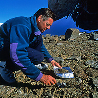 ANTARCTICA, Queen Maud Land.  Polar veteran David Rootes takes soil samples for base-line environmental survey of private flights to region.