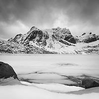 Walking on ice holds a special place in the terror section of my brain, and you can be certain I did not stray far from the shore of this beautiful frozen lake.  Lofoten Islands, Norway.