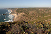 The southwest coast of Portugal, from cape St vincente, at the Algarve, until up to Zambujeira do Mar, at the Alentejo, is said to be among the most unspoiled coastlines of Europe. Although the touristic pressure is already very obvious at some spots, there are still plenty of beaches with almost no <br /> human marks. Castelejo is a beach west of Vila do Bispo, accessible through a road that goes up and donw the surrounding hills.