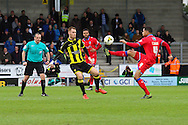 Oldham defender Timothee Dieng and Burton Albion midfielder Tom Naylor challenge for the ball during the Sky Bet League 1 match between Burton Albion and Oldham Athletic at the Pirelli Stadium, Burton upon Trent, England on 26 March 2016. Photo by Aaron Lupton.