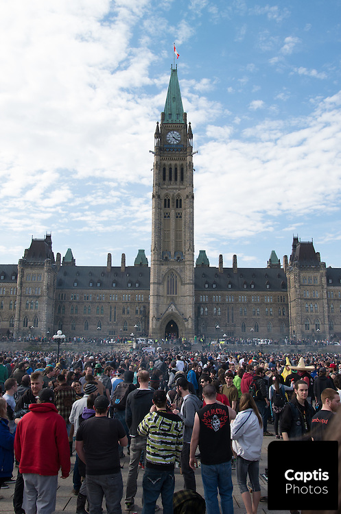Smoke rises at 4:20pm in front of Parliament Hill as protesters smoke marijuana en masse. April 20, 2014.