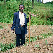 Kulika trained farmer Amos Manragaba during a week's residential training with Kulika in Uganda on sustainable organic farming. He is standing in a raised bed of cabbages. Compost manure was applied before planting.  The mulch here ensures that when it rains, water drains away without eroding the soil, thus preserving the nutrients.