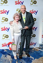 Jon Snow and guest attending the TRIC Awards 2019 50th Birthday Celebration held at the Grosvenor House Hotel, London.