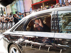 Brad Pitt waves to his fans as he arrives for the World War Z UK film premiere at The Empire, Leicester Square, London, United Kingdom, <br /> Sunday, 2nd June 2013<br /> <br /> Picture by Max Nash / i-Images