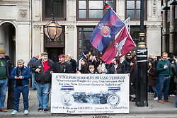 London, UK. 12th April 2019. Supporters of thousands of bikers riding over Westminster bridge and into Parliament Square as part of a Rolling Thunder Ride for Soldier F organised by Harry Wragg and other armed forces veterans in support of the 77-year-old former soldier known as Soldier F who is to be prosecuted for the murders of James Wray and William McKinney at a civil rights march in Londonderry on Bloody Sunday in 1972.