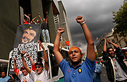 Chavistas hold up a banner with the image of South American revolutionary Ernesto Che Guevara at a rally in downtown Caracas, Venezuela, Friday, March 12, 2004.  The opposition, which is working to oust President Hugo Chavez, received a major blow last week when the government's National Electoral Council (CNE) said the opposition fell short on signatures for a petition to vote on an end to the Chavez persidency.  The constitution requires 2.4 million signatures for a recall vote.  While the opposition claims it collected 3.4 million votes, the CNE has validated only 1.8 million, sparking massive protests, and clashes between the opposition and Venezuelas National Guard.  Photographer: Emile Wamsteker