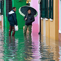 Two local men talk about the alarming rising water in Burano. More than 59% of Venice was under water on Thursday, as the historic lagoon town was hit by exceptionally high tides. The sea level rose above 140cm overnight and was expected to remain above critical levels for about 15 hours.