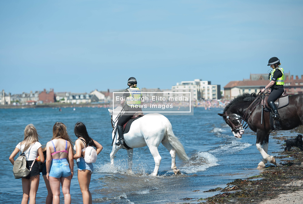 Mounted Police take their horses into the water to help them cool down during today's extremely hot weather. Troon Beach, Troon, Friday 26 May 2017 Angie Isac   EEm