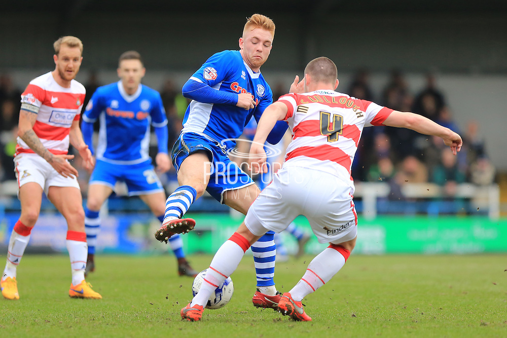Callum Camps, Luke McCullough during the Sky Bet League 1 match between Rochdale and Doncaster Rovers at Spotland, Rochdale, England on 2 April 2016. Photo by Daniel Youngs.