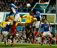 Photo: Ed Godden.<br /> Portsmouth v Arsenal. The Barclays Premiership. 12/04/2006. Alexandre Song (L) clashes with Linvoy Primus (Pompey)