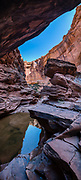 Canyon reflections. Hunter Canyon hiking trail, on BLM land, Moab Kane Creek Blvd, Moab, Utah, USA. The BLM (Bureau of Land Management) is part of the United States Department of the Interior. This image was stitched from multiple overlapping photos.