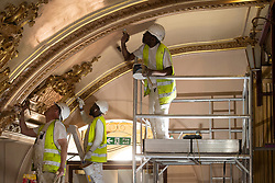 IMAGES SHOT ON APRIL 20TH 2021 © Licensed to London News Pictures. 12/05/2021. Blackpool, UK. Specialist painters work on the major conservation project taking place in the Tower Ballroom, in Blackpool, Lancashire on April 20, 2021. The Blackpool Tower Ballroom, located in the Grade 1 Listed Tower and which dates back to 1894, has undergone the most extensive programme of work and deep clean for more than 60 years totaling £1.1M. A team of skilled, specialist craftsmen, who have worked across the world on projects including the Queen's Gallery at Buckingham Palace, have dedicated more than 21,000 hours, over a period of six months, to restore the famous Ballroom to its original glory. Due to the Coronavirus pandemic the ballroom has now been closed for over 12 months and is scheduled to re-open to the public on June 21, 2021. Photo credit: Oli Scarff/LNP