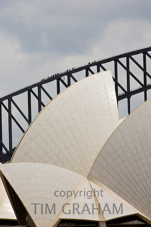 Sydney Opera House and tourists walking over  the Sydney Harbour Bridge walkway, Australia