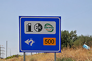 Israel, Galilee a road sign directing to a petrol station at the roundabout