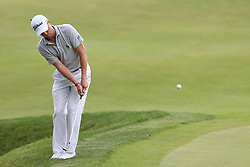 June 21, 2018 - Cromwell, Connecticut, United States - CROMWELL, CT-JUNE 21: Justin Thomas chips on to the 18th green during the first round of the Travelers Championship on June 21, 2018 at TPC River Highlands in Cromwell, Connecticut. (Credit Image: © Debby Wong via ZUMA Wire)