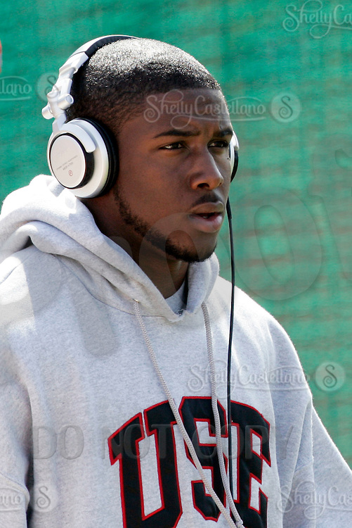 2 April 2006: Heisman winner Reggie Bush listening to MP3 music player Sony headphones arrives at pro-day timing workout by pro football teams at NFL pro-timing day at USC college campus in Los Angeles, CA.  NCAA College Football  Heisman Trophy winner Reggie Bush of the USC Trojans. Now a NFL player for the New Orleans Saints.