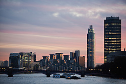 © Licensed to London News Pictures. 04/12/2013. London, United Kingdom. Westminster seen during a pink sunset. Photo credit : Andrea Baldo/LNP