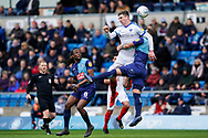 Oliver Hawkins of Portsmouth heads the under pressure from Adam El-Abd of Wycombe Wanderers during the EFL Sky Bet League 1 match between Wycombe Wanderers and Portsmouth at Adams Park, High Wycombe, England on 6 April 2019.