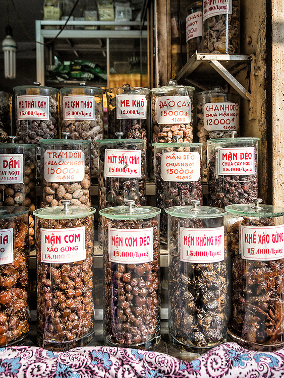 Jars of dried fruits in a shop along Hang Duong street in Hanoi's Old Quarter, Vietnam, Southeast Asia