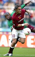 Roma 2/11/2003 <br />Roma Reggina 2-0 <br />Francesco Totti (Roma) contrastato da Gonzalo Martinez (Reggina)<br />A Challenge between Francesco Totti (Roma) and Gonzalo Martinez (Reggina)<br />Foto Andrea Staccioli Graffiti