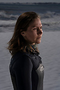 """Old Orchard Beach, Maine - March 24:<br /> Kate Strait, 38, of South Portland, in Old Orchard Beach, Maine, on Tuesday, March 24, 2020.  Strait has been surfing since she was in seventh or eighth grade.  """"In this chaos, everybody is trying to do the best that they can in a brand new situation. But it's been really stressful. And surfing has always been my church, it's a way for me to ground myself,"""" Strait said.  Strait is scientist-turned-science teacher.  She turned to teaching after encountering health problems from her chronic Lyme, which gives her a compromised immune system to contend with as she navigates the coronavirus.  """"I'm erring on the side of caution,"""" she said.  <br /> <br /> <br /> Photo by Sarah Rice for ESPN"""
