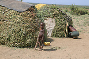 Young Hamer Tribe boy standing by his hut. Photographed in Omo River Valley, Ethiopia, Africa