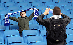 A Brighton and Hove Albion fan in the stands shows his support during the Premier League match at the AMEX Stadium, Brighton.